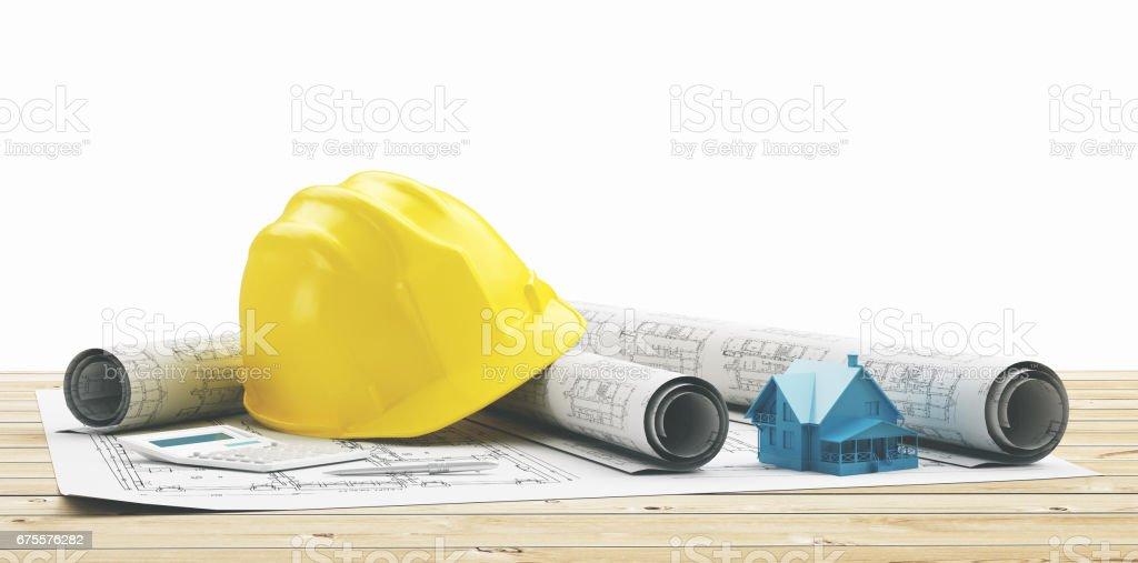 Elmetto giallo con progetti edilizi di casa nuova photo libre de droits