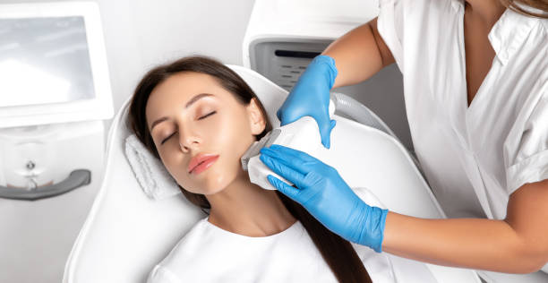 Elos epilation hair removal procedure on the face of a woman. Beautician doing laser rejuvenation in a beauty salon. Facial skin care. Hardware  ipl cosmetology stock photo
