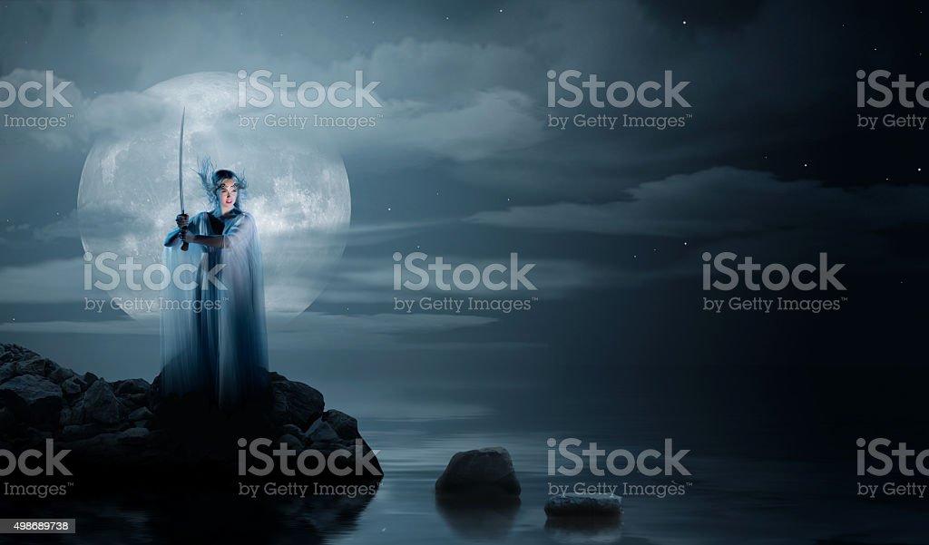 Elven girl on sea coast stock photo