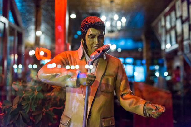 elvis statue display in retail small business beale street memphis - elvis stock photos and pictures
