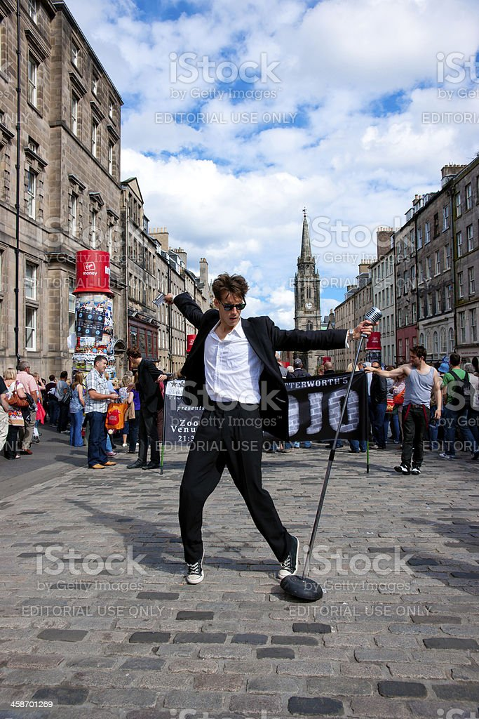 Elvis type character struts his stuff during the Edinburgh Fringe stock photo