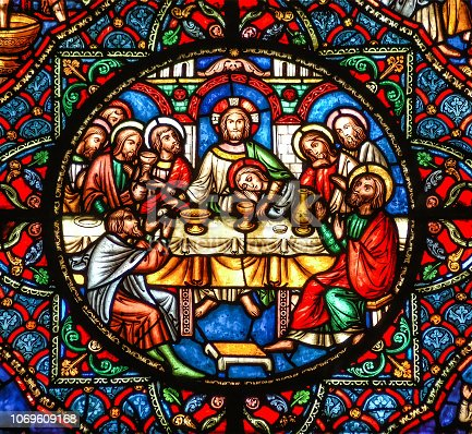 The last supper stained glass window showing Jesus  with the Apostles sitting at the table