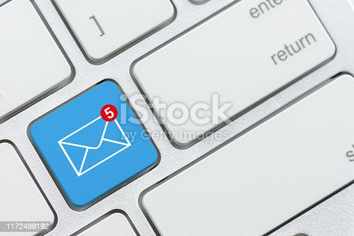 istock Email alert and message sending concept : Number 5 and envelope on blue computer keyboard button, depicts alert for unread / un-opened message, text messages in an inbox waiting for recipient to read 1172499192
