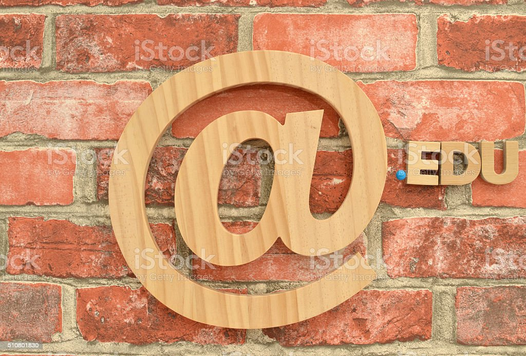 Email and Commercial At Symbol Dot EDU Brick Wall stock photo