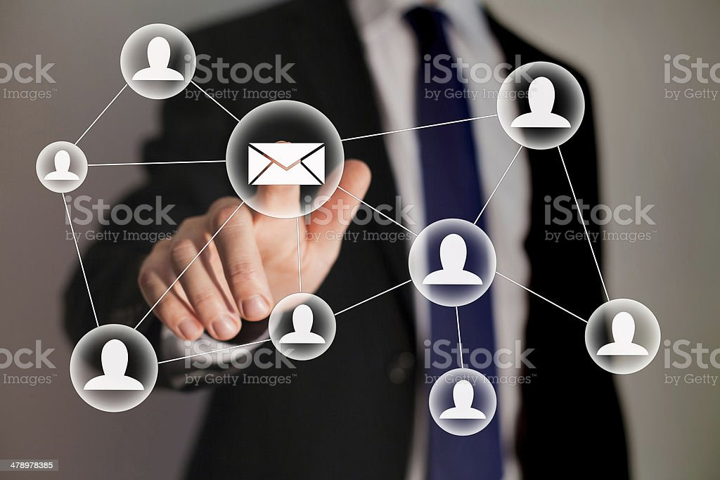 Email and contact symbols in front of businessman stock photo