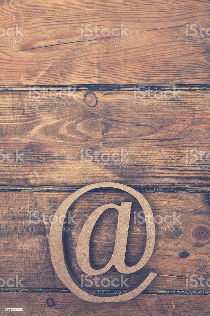 Email At Symbol On A Wooden Background Stock Photo More Pictures