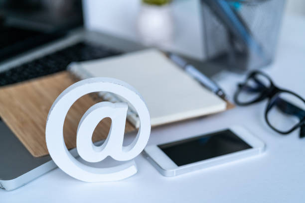 Email comcept. Contact us for feedback. Desktop with notepad, smartphone, glasses and email symbol. Top view Email comcept. Contact us for feedback. Desktop with notepad, smartphone, glasses and email symbol. Top view email signs stock pictures, royalty-free photos & images