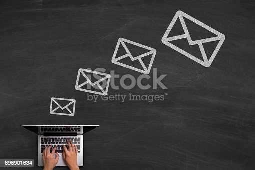 istock Email Concept With Laptop On Blackboard 696901634