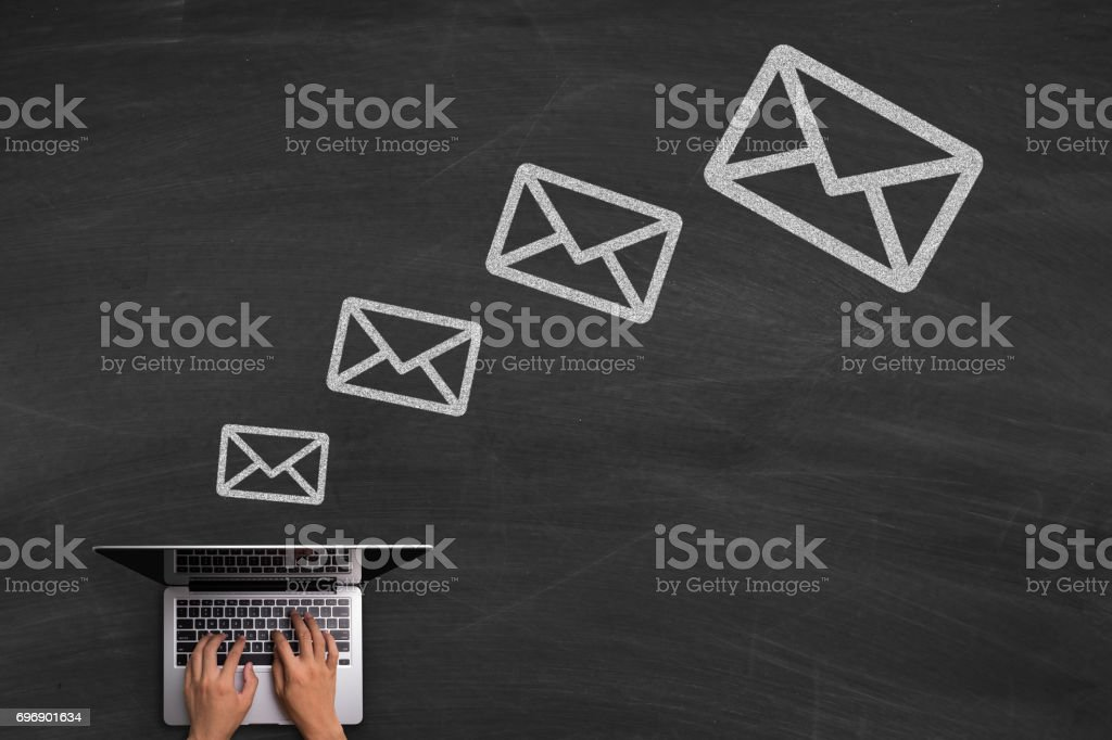 Email Concept With Laptop On Blackboard stock photo