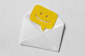 istock Email envelope with smiling message bubble on white background 1067891868