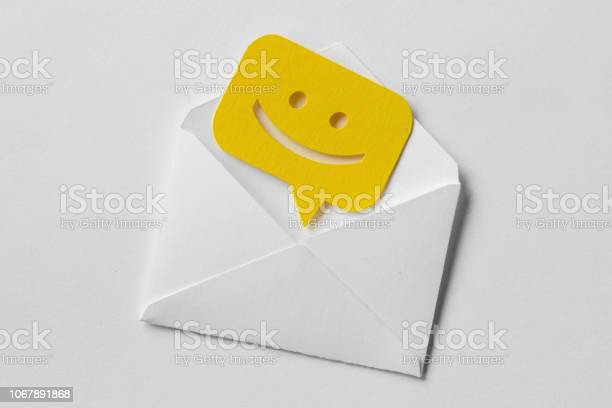 Email envelope with smiling message bubble on white background picture id1067891868?b=1&k=6&m=1067891868&s=612x612&h=nkahymunpmqczab1z5 wqepbnqtucgji 1alooawoc0=