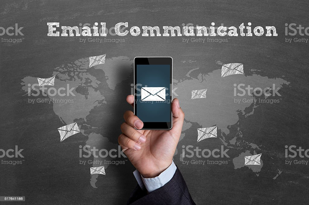 E-mail icon on mobile phone screen stock photo