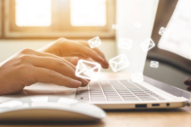 Email marketing and newsletter concept. Hand of man sending message and laptop with e-mail icon Email marketing and newsletter concept. Hand of man sending message and laptop with e-mail icon newsletter stock pictures, royalty-free photos & images