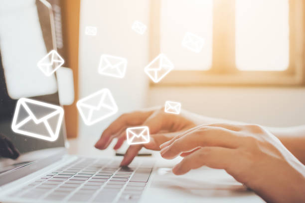 Email marketing and newsletter concept. Hand of man sending message and laptop with e-mail icon Email marketing and newsletter concept. Hand of man sending message and laptop with e-mail icon letter e stock pictures, royalty-free photos & images