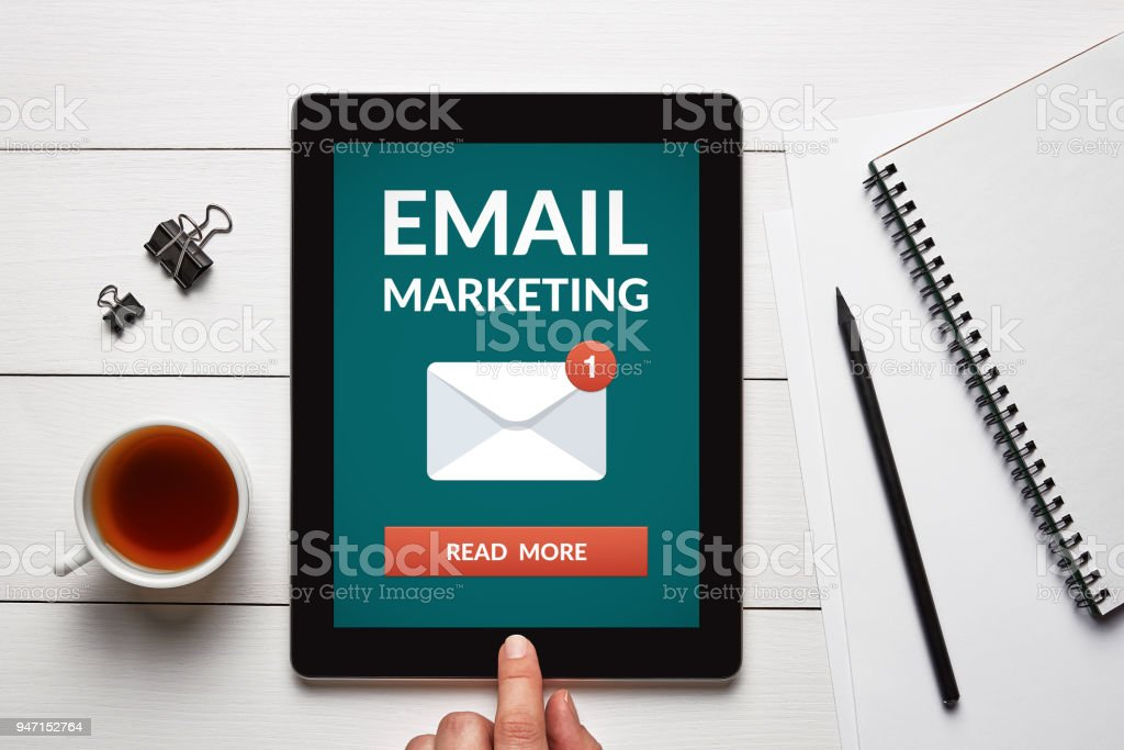 Email marketing concept on tablet screen with office objects stock photo