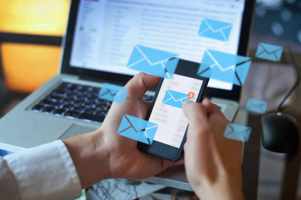 email marketing concept, person reading e-mail on smartphone stock photo
