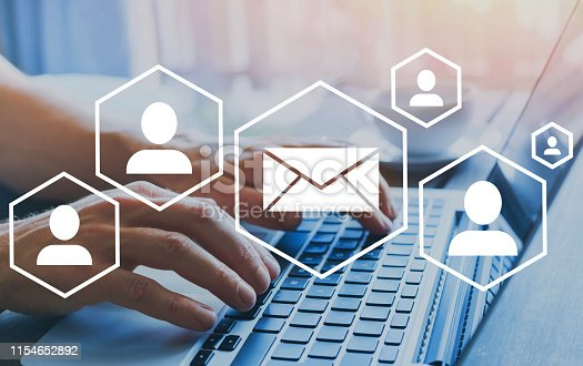 email marketing or newsletter concept, diagram with icons, hands typing on computer as background