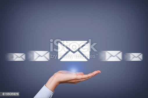 istock Email Sending Over Human Hand 615505926