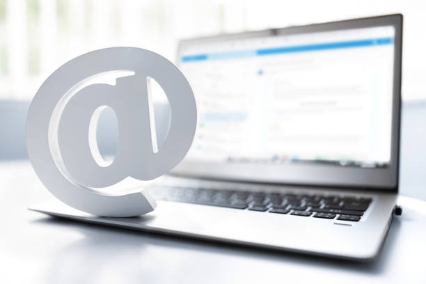 Email symbol on business laptop computer stock photo