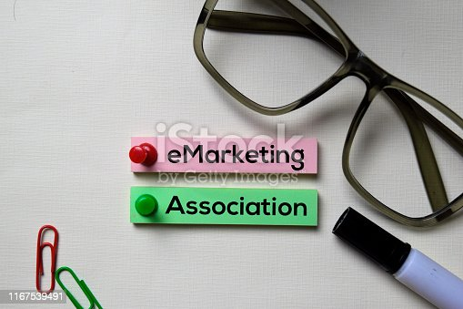 eMarketing Association - eMA text on sticky notes isolated on office desk