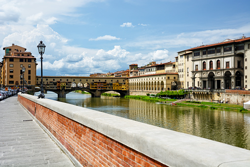 Reflection of Uffizi Gallery and Vasari Corridor in River Arno in Florence, Italy.