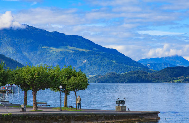 Embankment of Lake Zug in Switzerland Zug, Switzerland - 5 June, 2014: embankment of Lake Zug in the city of Zug. Zug is a city in Switzerland, it is the capital of the Swiss canton of Zug. zug stock pictures, royalty-free photos & images