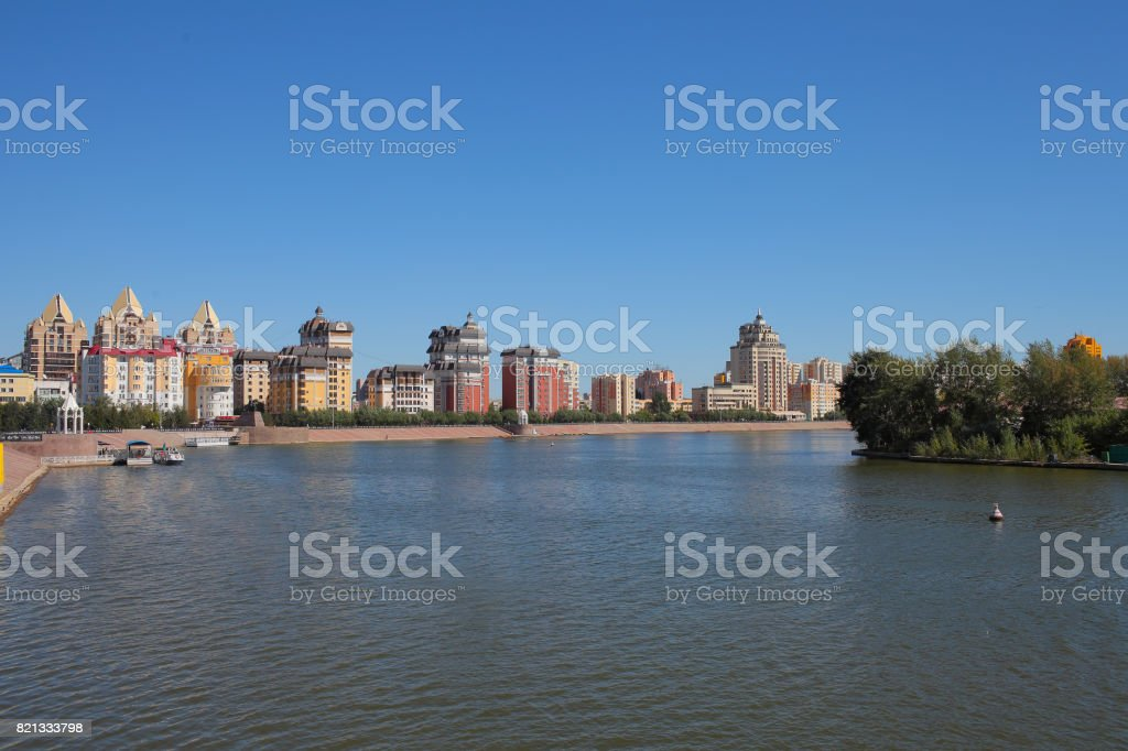 Embankment of the city with modern buildings stock photo