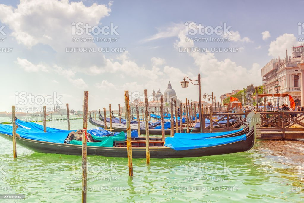 Venice,  Italy - May 12, 2017 : Embankment of the Grand Canal with Gondolas in Venice. stock photo