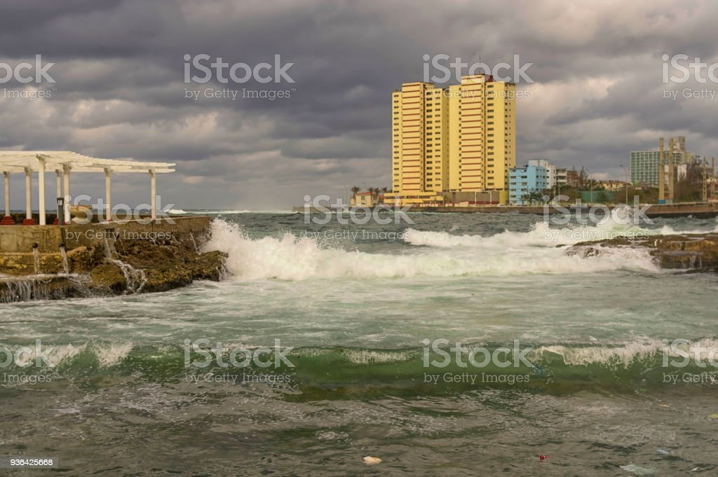 Embankment of the sea city during a storm, low storm clouds, lar