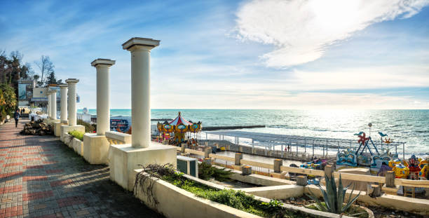 Embankment with white columns Embankment of the Black Sea in Sochi with white columns and children's carousels sochi stock pictures, royalty-free photos & images
