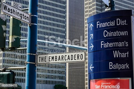 Sign for the Embarcadero, an open air market with architecture in the background in downtown San Francisco, California.