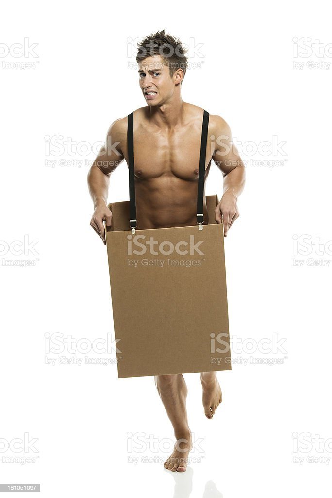 Embarrassed naked man in a box against white royalty-free stock photo
