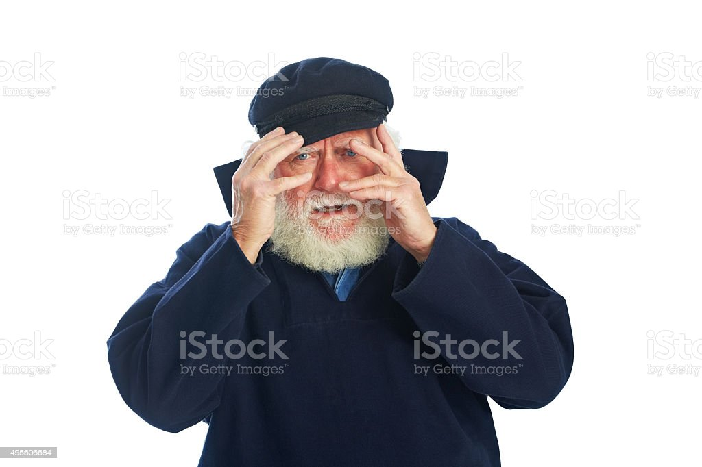 Embarrassed senior man hiding face with hands stock photo
