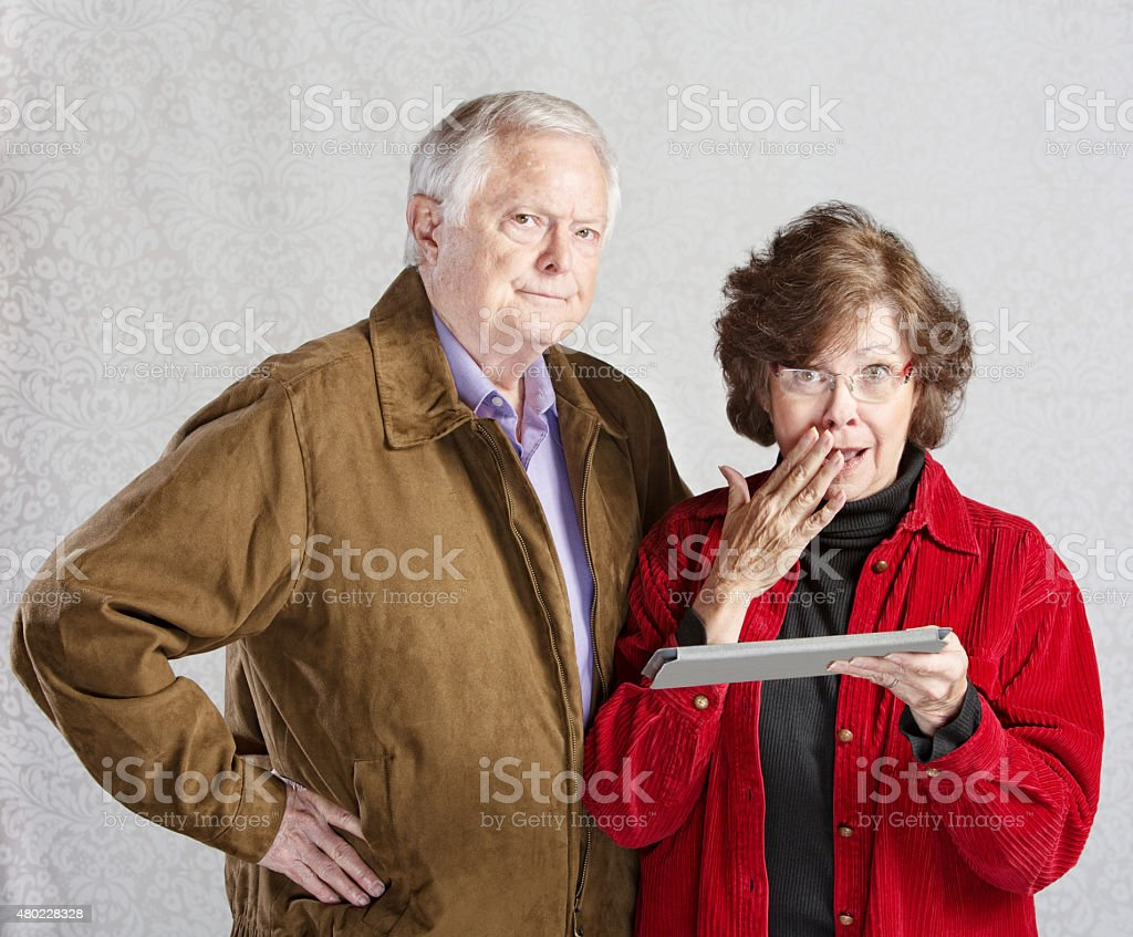 Embarrassed Woman with Tablet stock photo