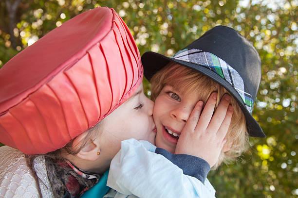 imbarazzo - kids kiss embarrassed foto e immagini stock