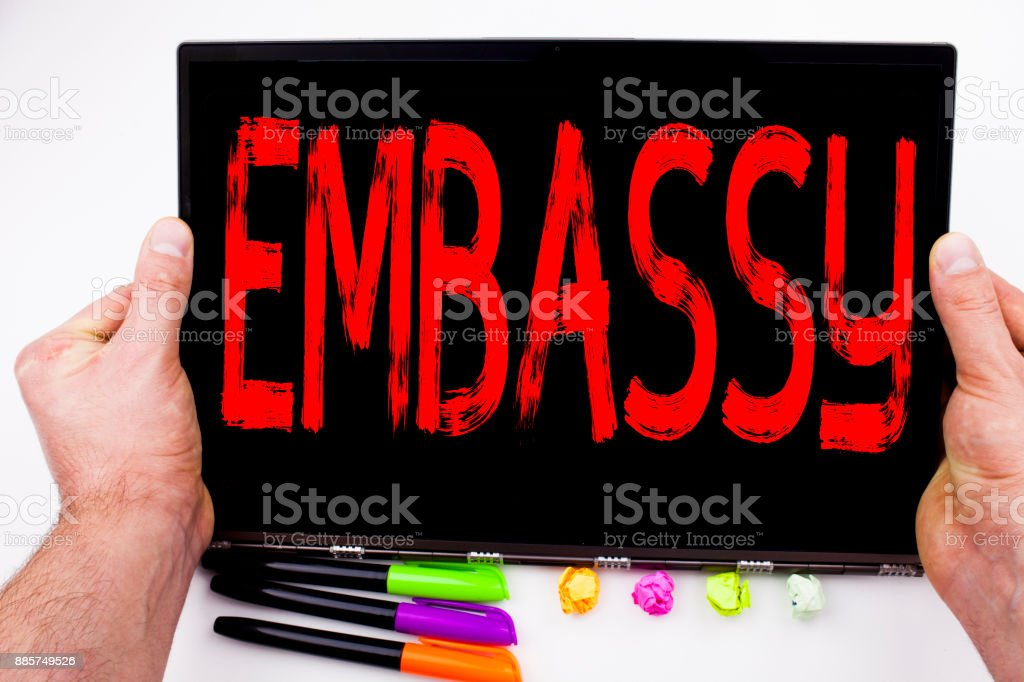 Embassy text written on tablet, computer in the office with marker, pen, stationery. Business concept for Tourist Visa Application white background with copy space stock photo
