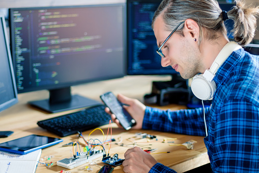 Embedded Developer Working With Microcontrollers Stock Photo - Download Image Now