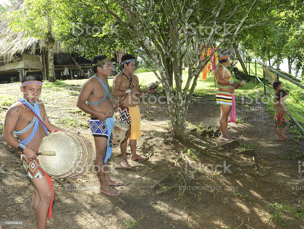 Embera chief and music band stock photo