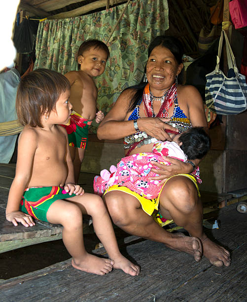 embera family in their cottage - embera indian women stock pictures, royalty-free photos & images