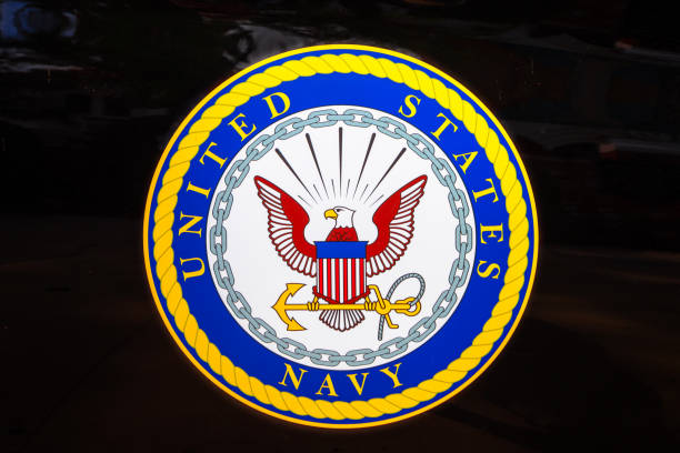 Emblem of the United States Navy San Diego, Navy pier, California, UNITED STATES - August 3, 2018: Emblem of the United States Navy isolated on a door of black car of United States Armed Forces. insignia stock pictures, royalty-free photos & images