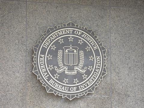 Washington, USA - August 11, 2009: FBI emblem on the J. Edgar Hoover F.B.I. Building in downtown Washington, DC.
