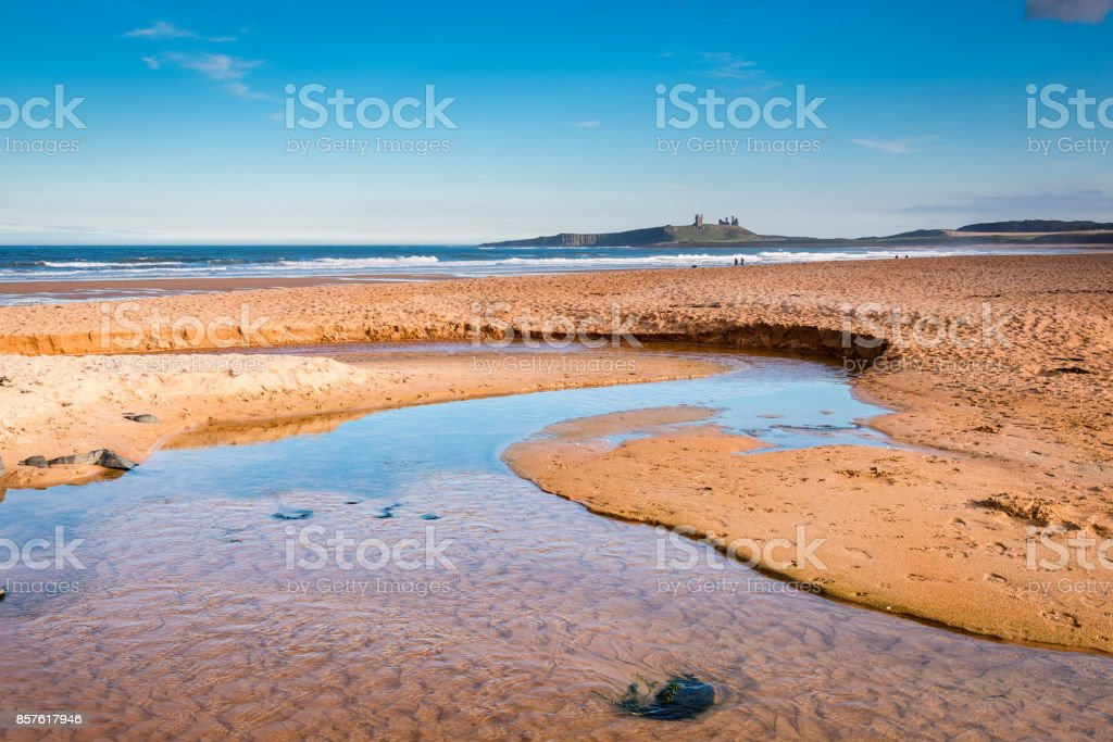 Embleton Beach and Burn stock photo