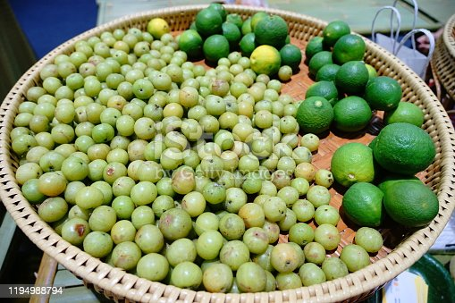Limes and Indian gooseberry in market