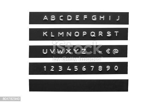istock Embossed alphabet on black plastic tape 804782940
