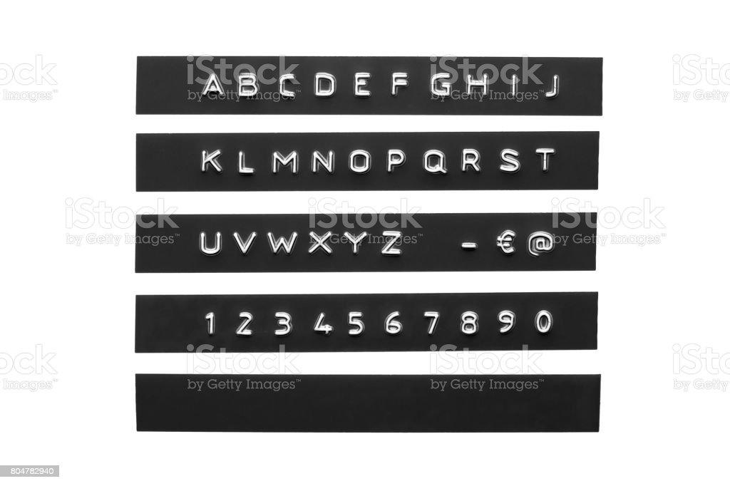 Embossed alphabet on black plastic tape stock photo