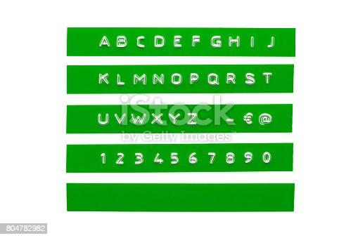 istock Embossed alphabet on green plastic tape 804782982