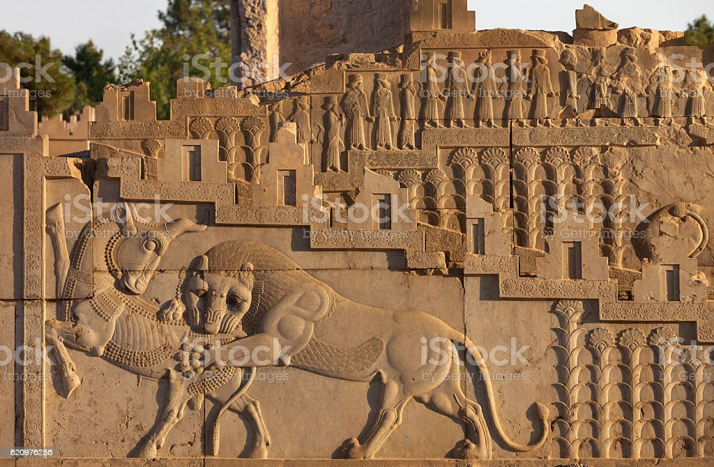 Embossed Combat Between Lion and Bull Carved on Persepolis Staircase stock photo