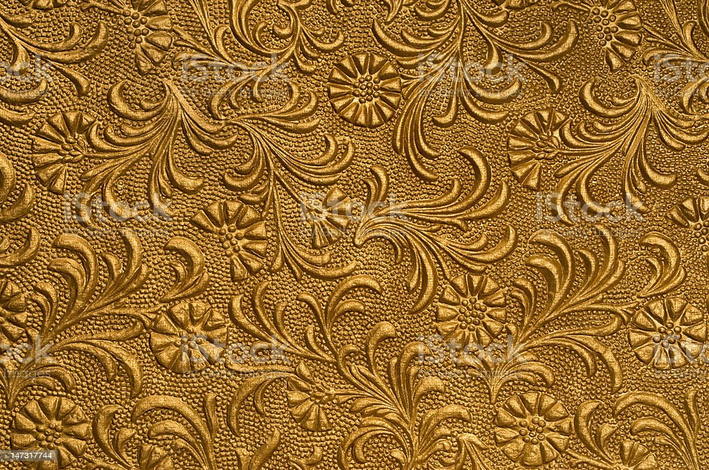embossed floral panel gold stock photo