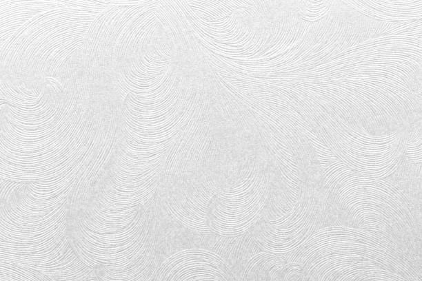 geprägte weißes papier mit floralem muster - brokat stock-fotos und bilder