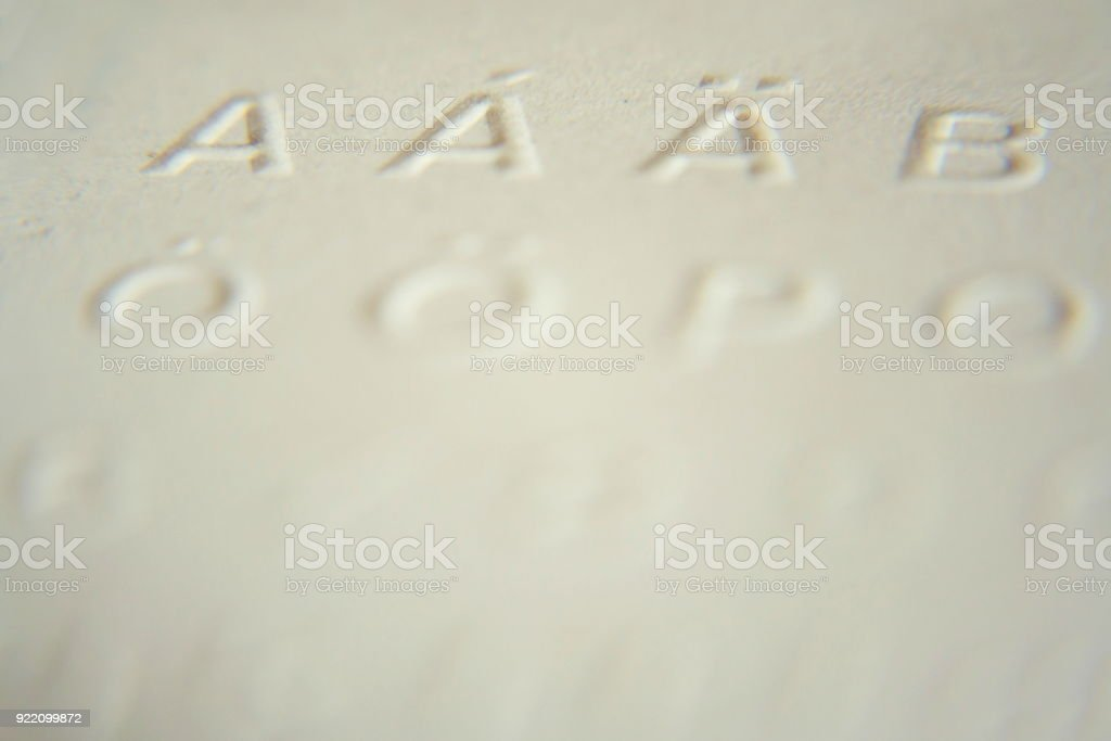 Embossed writing for blind people used before Braille writing system stock photo